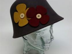 Crown cap felt cloche. With flowers